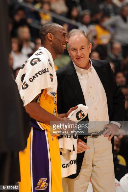 Kobe Bryant of the Los Angeles Lakers speaks with television personality Bill O'Reilly during a break in the action of a game against the Atlanta...