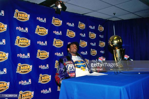 Kobe Bryant of the Los Angeles Lakers speaks with the media after Game Five of the 2001 NBA Finals on June 15, 2001 at the First Union Center in...