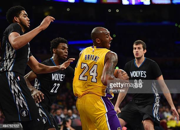 Kobe Bryant of the Los Angeles Lakers spins from KarlAnthony Towns Andrew Wiggins and Nemanja Bjelica of the Minnesota Timberwolves during the first...