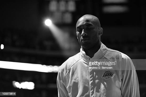 Kobe Bryant of the Los Angeles Lakers stands during the national anthem prior to Game Five of the Western Conference Quarterfinals against the...