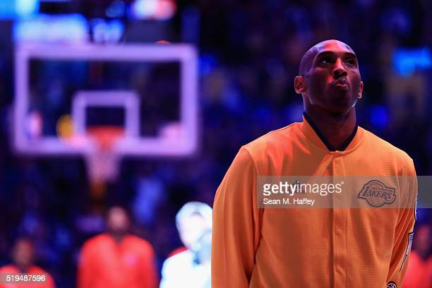 Kobe Bryant of the Los Angeles Lakers stands during the national anthem prior to the first half of an NBA game against the Los Angeles Clippers on...