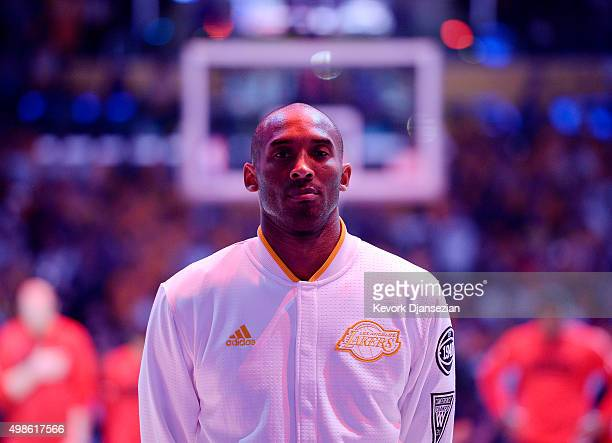 Kobe Bryant of the Los Angeles Lakers stands for the National Anthem before the start of the basketball game against the Portland Trail Blazers at...