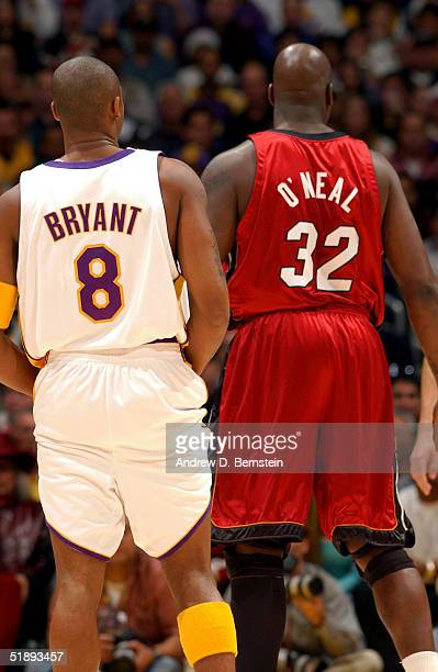 Kobe Bryant of the Los Angeles Lakers stands next to former teammate Shaquille O'Neal of the Miami Heat on December 25 2004 at the Staples Center in...