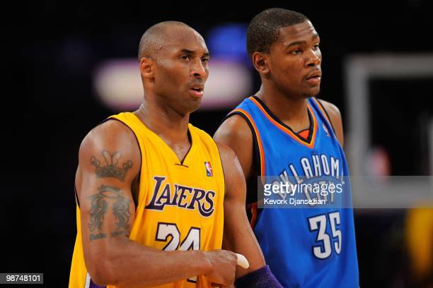 Kobe Bryant of the Los Angeles Lakers stands next to Kevin Durant of the Oklahoma City Thunder during Game Two of the Western Conference...