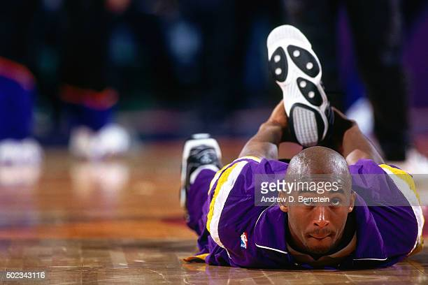 Kobe Bryant of the Los Angeles Lakers stretches against the Phoenix Suns on December 25 1996 at the America West Arena in Phoenix Arizona NOTE TO...