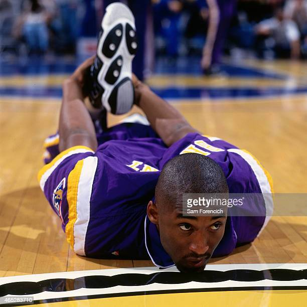 Kobe Bryant of the Los Angeles Lakers stretches prior to the game against the Golden State Warriors on November 19 1996 at The Arena in Oakland...