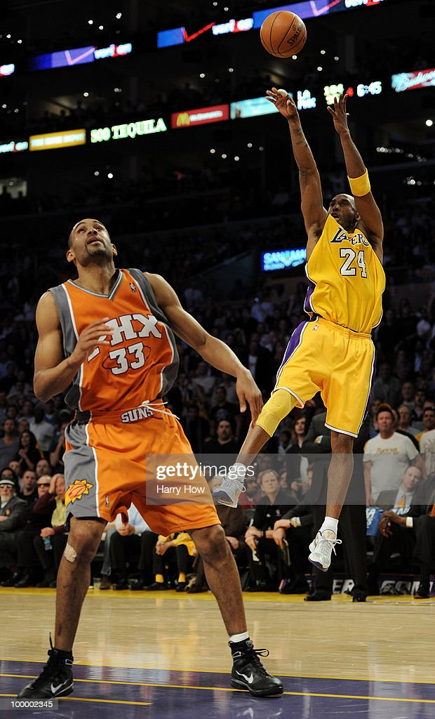 Kobe Bryant #24 of the Los Angeles Lakers takes a shot over Grant Hill #33 of the Phoenix Suns in the fourth quarter of Game Two of the Western Conference Finals during the 2010 NBA Playoffs at Staples Center on May 19, 2010 in Los Angeles, California.