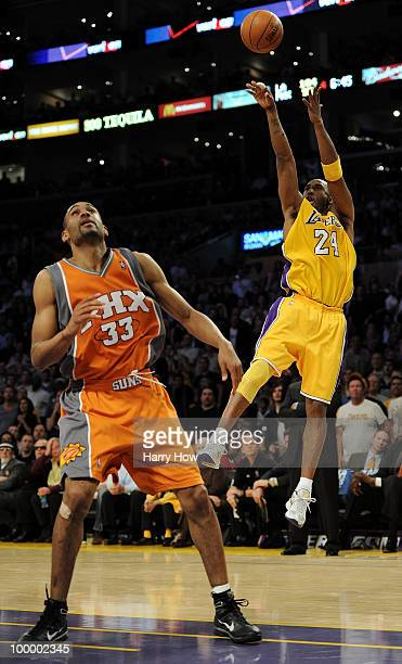 Kobe Bryant of the Los Angeles Lakers takes a shot over Grant Hill of the Phoenix Suns in the fourth quarter of Game Two of the Western Conference...