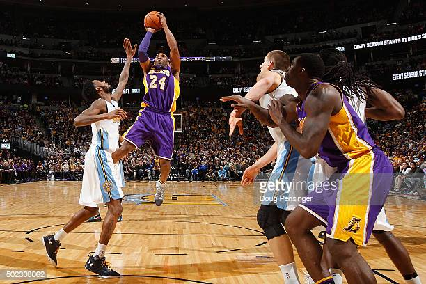 Kobe Bryant of the Los Angeles Lakers takes a shot over Will Barton of the Denver Nuggets at Pepsi Center on December 22 2015 in Denver Colorado The...