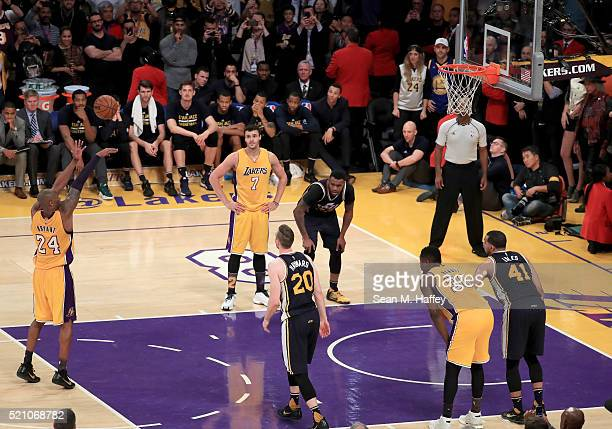 Kobe Bryant of the Los Angeles Lakers takes his final shot a free throw late in the fourth quarter to score his 60th point against the Utah Jazz at...