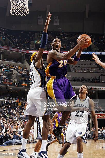 Kobe Bryant of the Los Angeles Lakers takes the ball to the basket against Hakim Warrick of the Memphis Grizzlies during the NBA game at FedExForum...