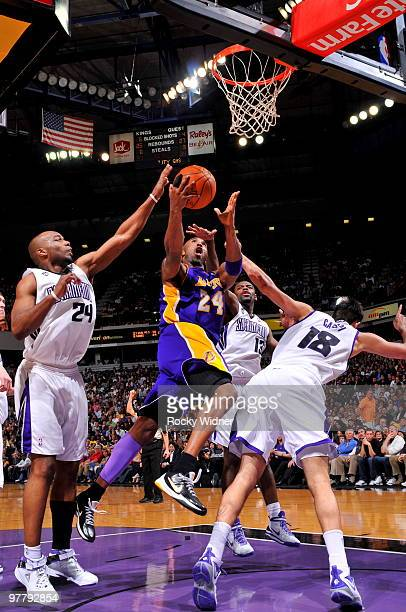 Kobe Bryant of the Los Angeles Lakers takes the ball to the basket against Omri Casspi of the Sacramento Kings on March 16 2010 at ARCO Arena in...
