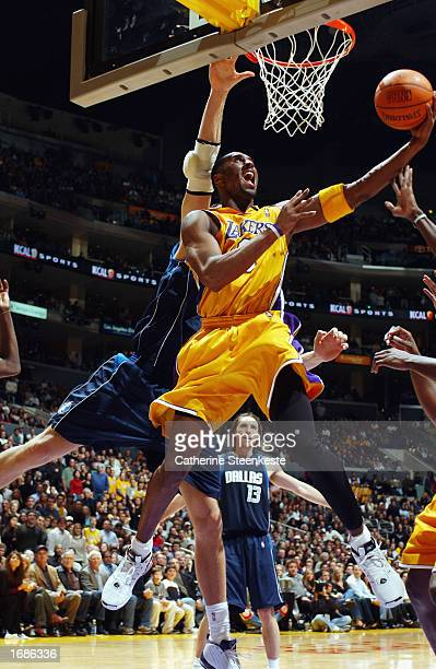 Kobe Bryant of the Los Angeles Lakers takes the ball to the hoop against the Dallas Mavericks during the NBA game at Staples Center on December 6,...
