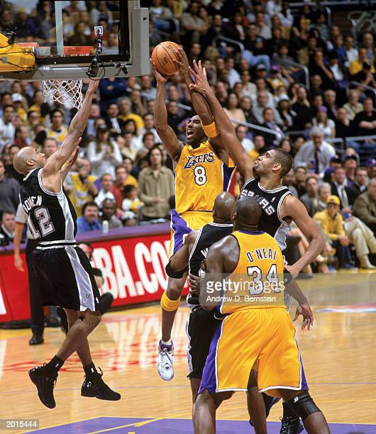 Kobe Bryant of the Los Angeles Lakers takes the ball up against Bruce Bowen and Tim Duncan of the San Antonio Spurs in Game Six of the Western...
