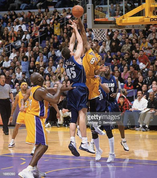 Kobe Bryant of the Los Angeles Lakers takes the ball up for the dunk as Raef LaFrentz of the Dallas Mavereicks tries blocking during the game at...
