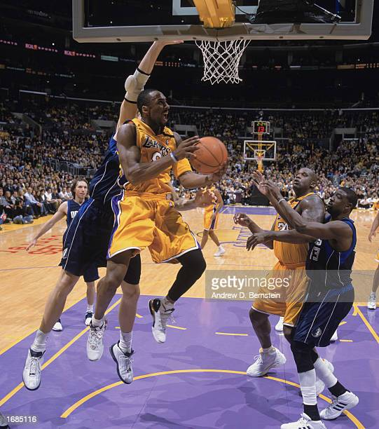 Kobe Bryant of the Los Angeles Lakers takes the ball up for the dunk during the game at against the Dallas Mavereicks at Staples Center on December...