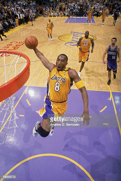 Kobe Bryant of the Los Angeles Lakers takes the ball up for the dunk during the game against the Sacramento Kings at Staples Center on April 10, 2003...