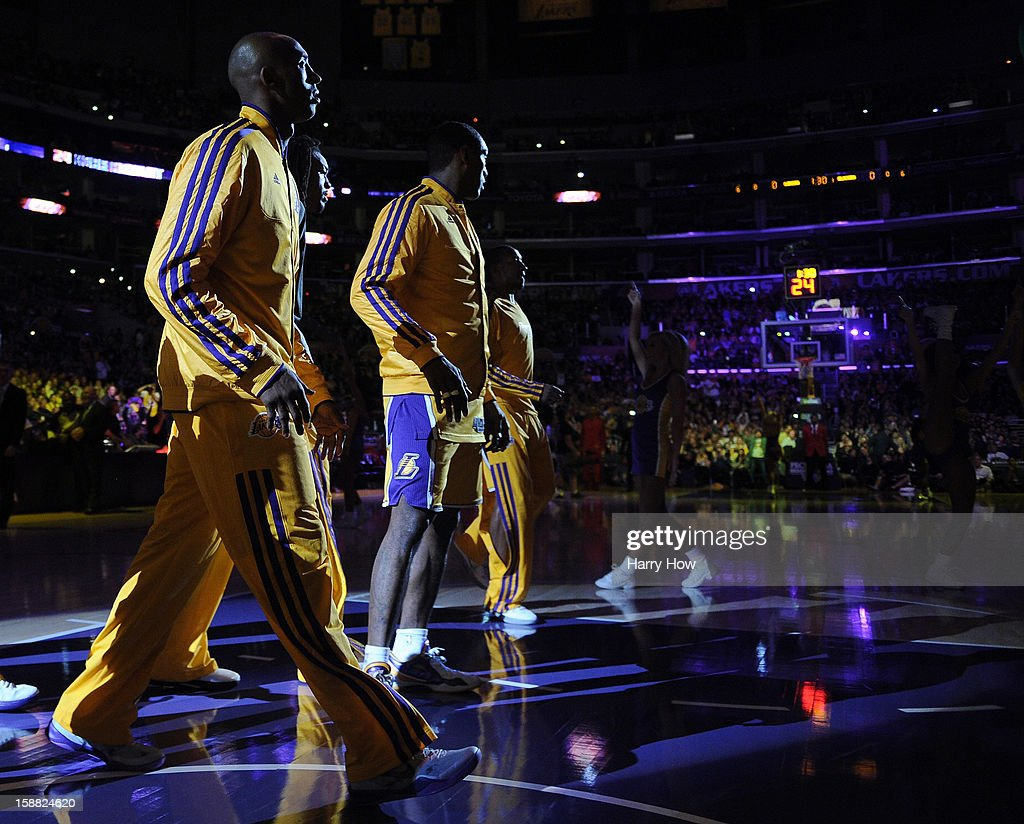 Kobe Bryant #24 of the Los Angeles Lakers takes the court during introductions before the game against the Portland Trail Blazers at Staples Center on December 28, 2012 in Los Angeles, California.