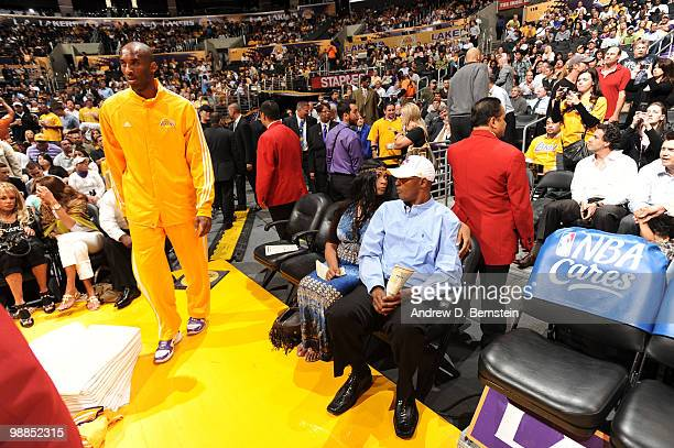 Kobe Bryant of the Los Angeles Lakers takes the court while his parents Pam Bryant and Joe Bryant look on before a game against the Utah Jazz in Game...