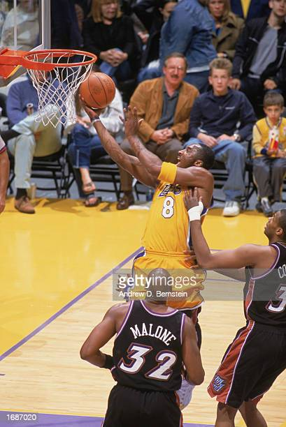 Kobe Bryant of the Los Angeles Lakers takes the layup during the game against the Utah Jazz at Staples Center on December 8, 2002 in Los Angeles,...