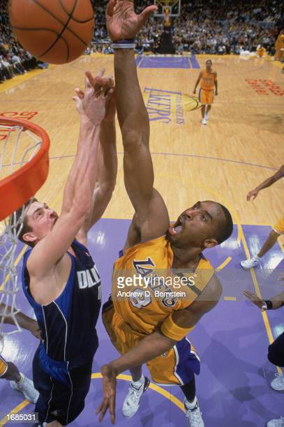 Kobe Bryant of the Los Angeles Lakers takes the shot during the game against the Dallas Mavereicks at Staples Center on December 6, 2002 in Los...