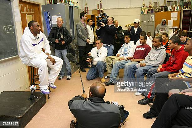 Kobe Bryant of the Los Angeles Lakers talks to a classroom of students while visiting his alma mater Lower Merion High School March 9 2007 in...