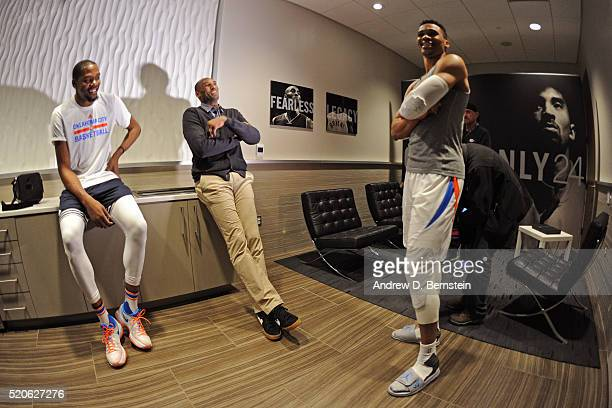 Kobe Bryant of the Los Angeles Lakers talks to Kevin Durant and Russell Westbrook of the Oklahoma City Thunder after the game at Chesapeake Energy...