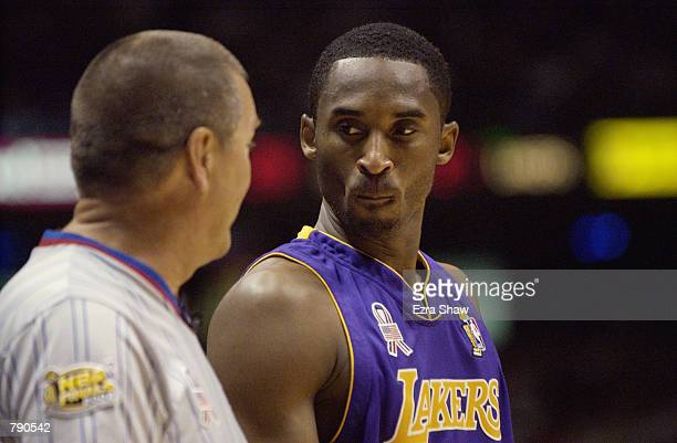 Kobe Bryant of the Los Angeles Lakers talks to referee Bernie Fryer in Game four of the 2002 NBA Finals against the New Jersey Nets at Continental...