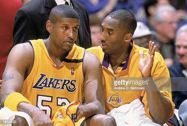 Kobe Bryant of the Los Angeles Lakers talks to Samaki Walker during the NBA game against the San Antonio Spurs at Staples Center on February 14 2003...