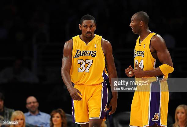 Kobe Bryant of the Los Angeles Lakers talks to teammate Ron Artest during a preseason game against the Los Angeles Clippers at Staples Center on...