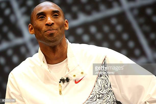 Kobe Bryant of the Los Angeles Lakers talks to the crowd at the unvieling of the Nike Hyperdunk shoe at the Nike Beijing 08 Innovation Summit on...