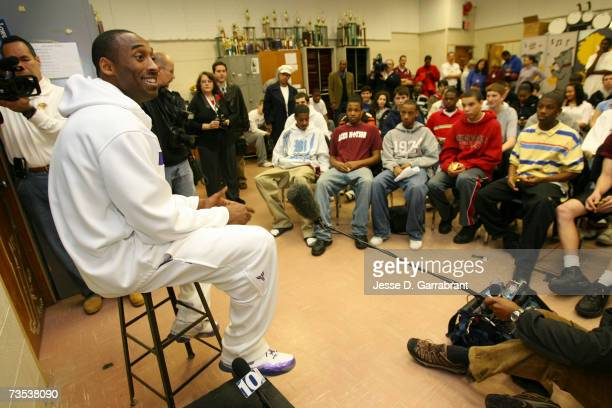 Kobe Bryant of the Los Angeles Lakers talks with a classroom full of students while visiting his alma mater Lower Merion High School March 9 2007 in...