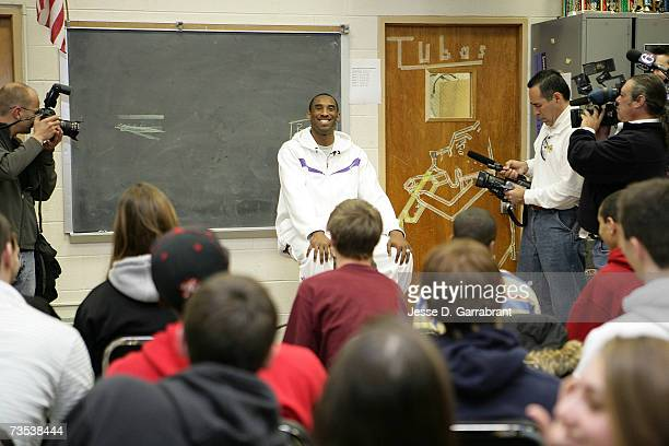 Kobe Bryant of the Los Angeles Lakers talks with a classroom of students while visiting his alma mater Lower Merion High School March 9 2007 in...