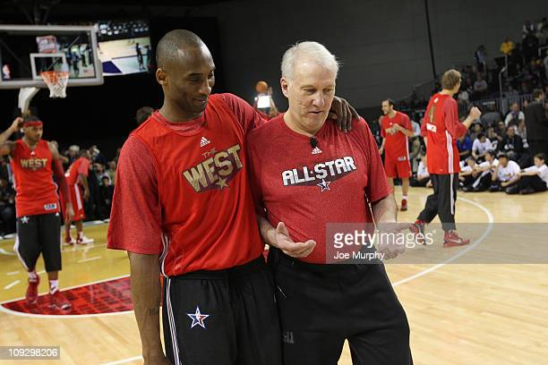 Kobe Bryant of the Los Angeles Lakers talks with Gregg Popovich Head Coach of the San Antonio Spurs during the East West AllStar Practice on center...