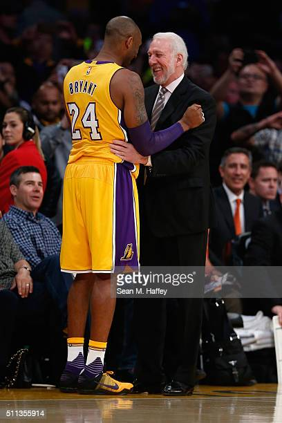 Kobe Bryant of the Los Angeles Lakers talks with head coach Gregg Popovich of the San Antonio Spurs prior to a game at Staples Center on February 19...
