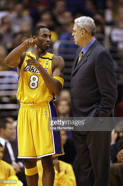 Kobe Bryant of the Los Angeles Lakers talks with head coach Phil Jackson during the game against the Atlanta Hawks at Staples Center on November 12...