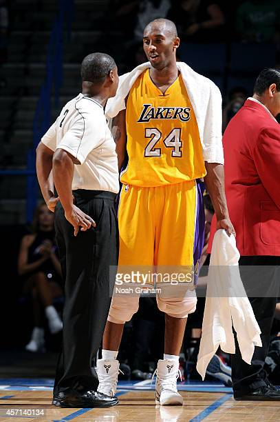 Kobe Bryant of the Los Angeles Lakers talks with referee Leroy Richardson during the game against the Golden State Warriors on October 12 2014 at...