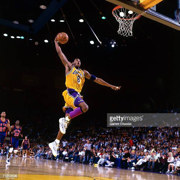Kobe Bryant of the Los Angeles Lakers throws down a dunk against the New York Knicks March 28 1999 at The Great Western Forum in Inglewood California...