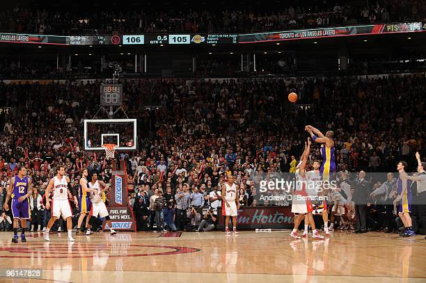 Kobe Bryant of the Los Angeles Lakers throws up a last second shot to win the game, but rattles out during a contest against the Toronto Raptors on...