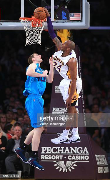 Kobe Bryant of the Los Angeles Lakers tries for the dunk after being fouled by Cody Zeller of the Charlotte Hornets in the first half during the NBA...