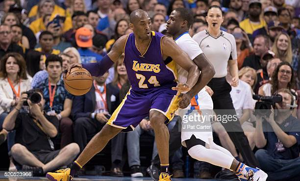 Kobe Bryant of the Los Angeles Lakers tries to drive around Dion Waiters of the Oklahoma City Thunder during the second quarter of a NBA game at the...