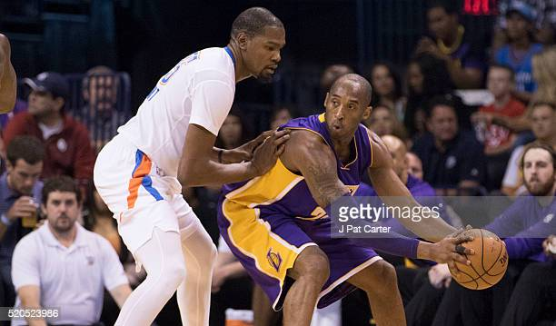 Kobe Bryant of the Los Angeles Lakers tries to drive around Kevin Durant of the Oklahoma City Thunder during the first quarter of a NBA game at the...
