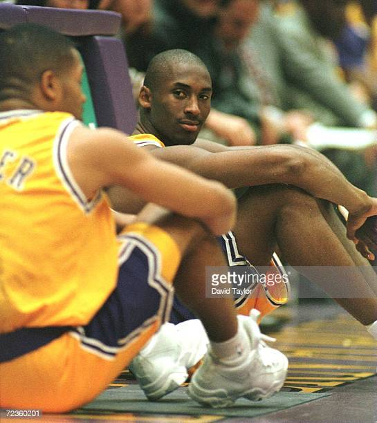 Kobe Bryant of the Los Angeles Lakers waits to enter the game for his first professional minutes during the first quarter during the game against the...