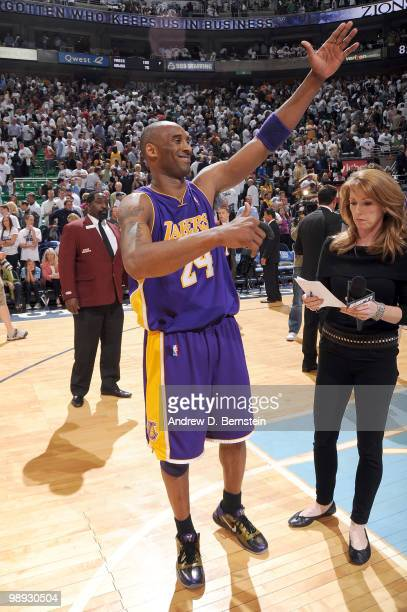 Kobe Bryant of the Los Angeles Lakers waives to his parents after their win against the Utah Jazz in Game Three of the Western Conference Semifinals...