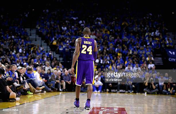 Kobe Bryant of the Los Angeles Lakers walks back down court during their game against the Golden State Warriors at ORACLE Arena on November 1 2014 in...