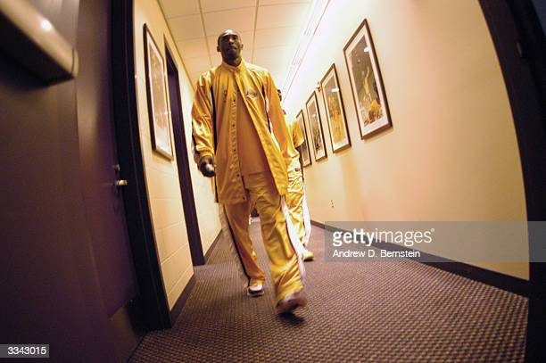 Kobe Bryant of the Los Angeles Lakers walks in the hallway outside the locker room before the game against the Houston Rockets at Staples Center on...