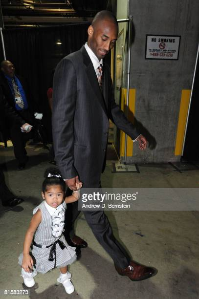 Kobe Bryant of the Los Angeles Lakers walks out of the arena with daughter Gianna following his team's victory over the Boston Celtics in Game Five...