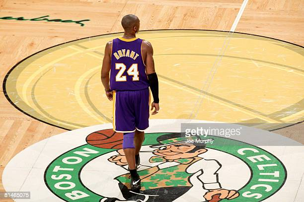 Kobe Bryant of the Los Angeles Lakers walks over the Boston Celtics logo during Game One of the 2008 NBA Finals on June 5, 2008 at TD Banknorth...