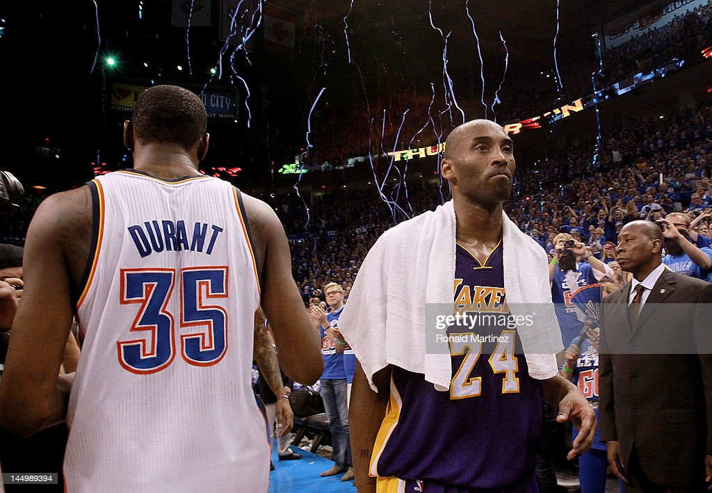 445fd332deda Kobe Bryant of the Los Angeles Lakers walks past Kevin Durant of the ...