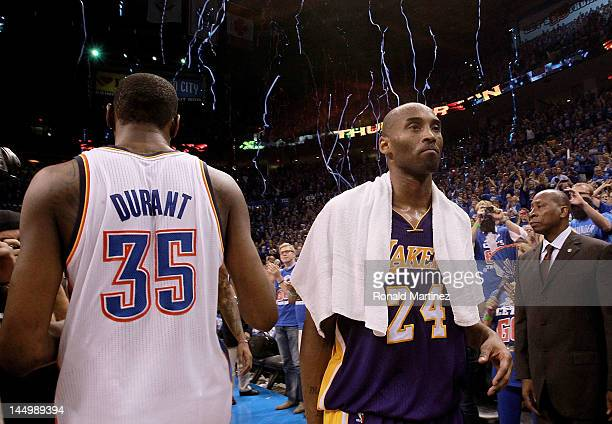 Kobe Bryant of the Los Angeles Lakers walks past Kevin Durant of the Oklahoma City Thunder after a 10690 loss during Game Five of the Western...